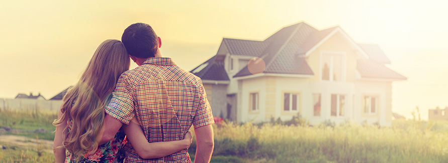 young couple looking at new home