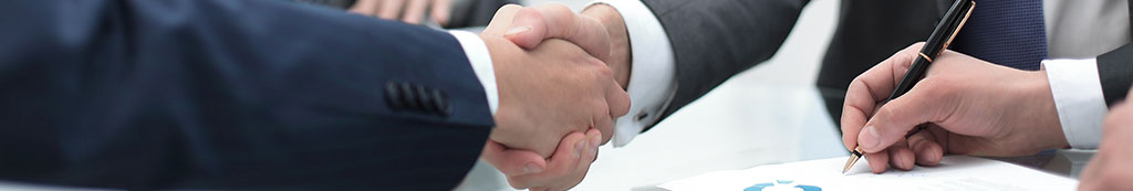 men shaking hands at meeting